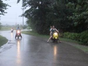 Driving our mopeds home in the rain