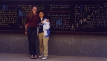 With Mo Qinglin, the Chinese student who hosted me in Hangzhou in September 1999, in front of the announcements board at her school.