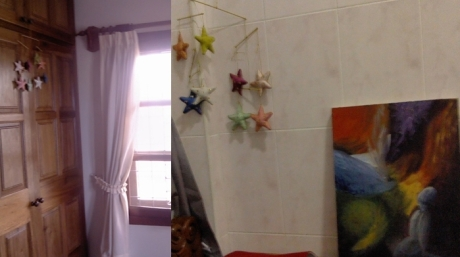Stars hanging in by the window where I stayed my first few days, and next to a painting in my home here.