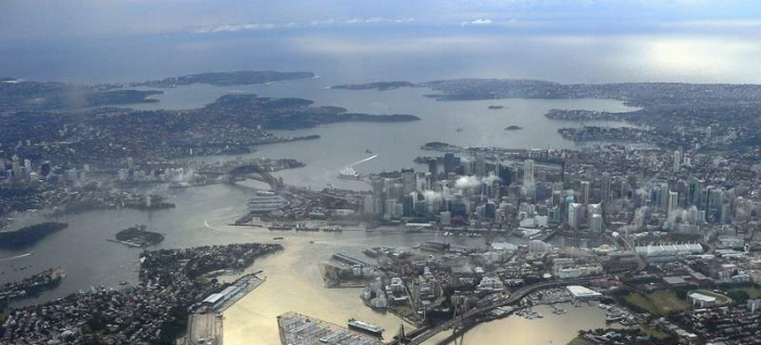 Port Jackson from the air: looking east from Darling Harbour to Sydney Harbour Bridge and across Sydney Harbour, as it curves north (left) up to Sydney Heads - then out over the Tasman Sea.